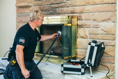 Sweeping a chimney with a digital camera in an Alabama fireplace.